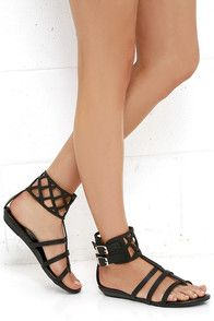 All is right with the world when you have the Coconuts Archie Black Gladiator Sandals on your feet, and a cocktail in-hand! Ultra-sleek vegan leather creates a cage-y thong upper, and cutout ankle strap with two adjustable silver buckles. Available in whole sizes only. #CuteDresses #TrendyTops, #FashionShoes #JuniorsClothing