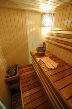 Sauna with dark brown benches and bright walls