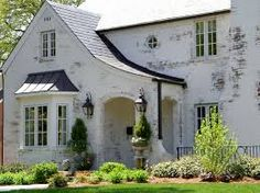 Image result for white brick row house with black bump out window