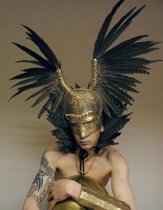 Excellent shape ~ previous pinner. Do you reckon they were talking about the headdress? #feathers #headdresses