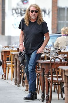 Robert Plant has fun with photographers as he has lunch with his girlfriend Katrina Chester and another woman.