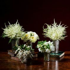 New Year's Eve Winter White Arrangement: Keep this collection lively by clipping stems and replacing water each day.