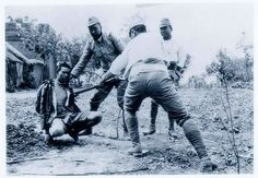 Japanese soldiers use live Chinese soldiers captured in the Xuzhou area for bayonet practice. (May 1938)