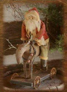 Prim Santa...on his grungy reindeer...with wheels.