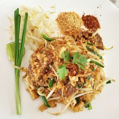 Pad thai. #Thai rice noodles deliciousness, savory, tart and sweet with crushed peanuts, chilli flakes and fresh bean sprouts.
