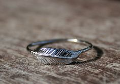 Feather sterling silver ring by ArmoredJewelry on Etsy, $30.00. Yes, please. Seriously love this.