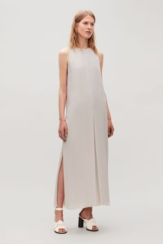 24a49339456d See more. Model side image of Cos sleeveless dress with slits in brown Slit  Dress