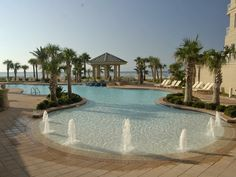 The Indigo Resort in Perdido Key features an incredible tropical pool with a waterfall and luscious vegetation.