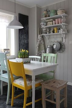 mismatched chairs, white table