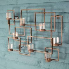 I've just found Contemporary Tealight Holder Garden Wall Art. This stylish metal wall art looks equally elegant hung in the home or garden. Wrought Iron Wall Art, Outdoor Metal Wall Art, Metal Art, Garden Wall Art, Metal Candle Holders, Metal Wall Sculpture, Geometric Wall Art, Elegant Home Decor, Living Room Lighting