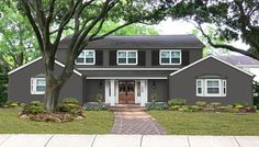 iron mountain house black trim - Google Search Colonial House Exteriors, Colonial Exterior, Stucco Exterior, Grey Exterior, House Paint Exterior, Paint Colors With White Trim, Dark Paint Colors, Stucco House Colors, Grey Brick Houses