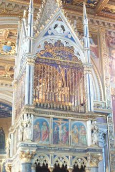 Detail of the beautiful canopy of St. John Lateran above the main altar, with 2 silver gilded busts which contain the heads of the apostles Peter and Paul.