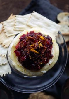 Baked Brie Cheese with Sweet Cranberry-Apple Relish with Orange and Currants, and topped off with crispy bacon!