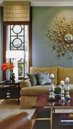 bronze, camel, tan, gold, silver, white, dark wood, gray blue wall, orange splash.