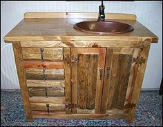 Photo of Front View - Rustic Bathroom Vanity: Log Cabin Vanity with Hammered Copper Sink and Bronze Faucet