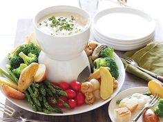 Easy Cheesy Fondue with Fingerling Potatoes, French Bread and Select Vegetables recipe from Rachael Ray via Food Network