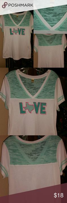Texas tee turquoise tshirt baseball top White with turquoise and pink Love Texas Tee....Gently worn.....shows light wear.  Fits like a loose large or a fitted xl.  Material is stretchy. Tops Tees - Short Sleeve