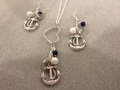 """Enjoy this 3-piece set which includes 2 dangle earrings and one (1) matching charm hung on a Sterling Silver 20"""" Chain.Dangles pictured are:(1) Navy Blue Pearl(1) Clear Crystal(1) White Pearl (1) Pewter Glossy Finish Fouled AnchorAll hung from a heart!Any color combination possible.More than Three (3) dangles can be added!!!"""