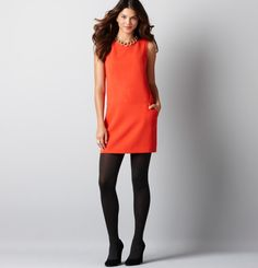 Love the orange dress...pair it with a purple sweater and you are all set!
