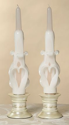 "Lillian Rose Pair of Ivory Carved Scroll Heart Tapers Each 10"" tall ivory taper candle in this pair has a scroll heart design carved out of wax. Price $6.50"