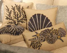 Navy Beaded & Embroidered Shell Pillows on an ivory ground.  So intricate and delicate, check them out up close to see how lovely they really are!