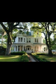 Gorgeous Southern home... I love the wrap around porch
