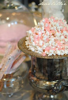 Lillie's Pink Cinderella Party: Edna's note-- use this kind of pink candy coating to make Designer Popcorn and place in titled popcorn bags for GIFT BAGS