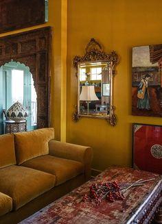Elizabeth Vallion Interiors Saffron yellow living room with velvet sofa and moorish doorway Yellow Walls Living Room, Yellow Painted Walls, Room Colors, Paint Colors, Mustard Living Rooms, Room Wall Painting, Mustard Yellow Paints, Yellow Living Room, Living Room Red