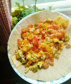 Weight Watchers 10 Point Big Breakfast Burrito -Filling, Healthy and Yummy!  1 Lg Mission Carb Balance Whole Wheat Burrito---2 Eggs---1-2 Cups chopped veggies (I used red onion, orange bell pepper, green chili pepper and tomato)---1 Slice 2% Cheese (I used Lucerne 2% American)---Seasonings... garlic powder, red pepper flakes, italian seasonings or whatever you like.   Heat veggies 3+ min. (use cooking spray), add eggs. Cook until firm. Pour over cheese strips on tortilla. A guilt-free…