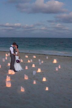 our candle bags picture on the beach; wedding picture ideas. I really like this, and it looks perfect like this with the time of day that it is.