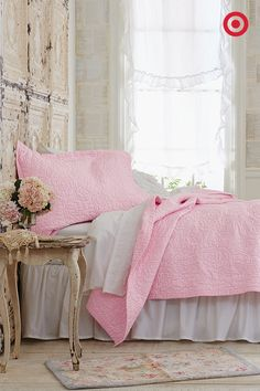 Did someone say breakfast in bed? This light pink Simply Shabby Chic quilt and shams makes a bedroom look warm and romantic, and adding vintage details, like a rug and bedside table, completes the retro-chic feel.