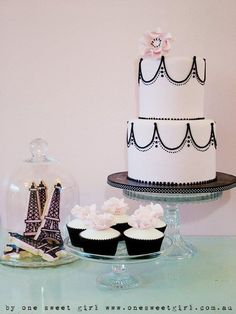 stunning pink and black lace cake, flower topped cupcakes and Eiffel Tower cookies - from 'one sweet girl'