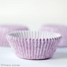 I bought these pretty tonal floral cupcakes cases whilst on holiday in Copenhagen, I just adored the colours they came in and that they had matching napkins, paper covered boxes and even a printed tin Floral Cupcakes, Cupcake Cases, Baking Cups, Covered Boxes, Lilac, Lavender, Holiday, Vacations, Syringa Vulgaris