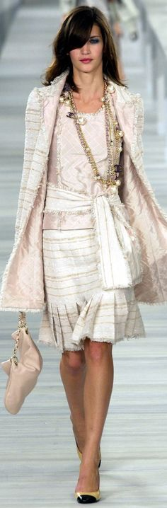 I chose this for the color. Chanel is often Youthful and Romantic, (and Classic - as in the pleats and jacket shape here) but this one has a lot of sparkle and sheen, taking it into the Angelic range.