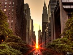 Manhattanhenge, is the term used to describe a biannual occurrence in New York City when the sun aligns with the east-west streets of Manhattan's main grid. Adopted in 1811 the famous street grid of Manhattan, the Commissioners' Plan, was the original design plan for the streets in which the grid plan is offset at 29.0 degrees from true east-west. Twice a year photographers gather to witness this urban solar phenomenon, when the sun sets perfectly between the skyscraper corridors.
