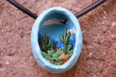by Camille Young ... Tiny desert diorama pendant 1 1/2 inches tall, polymer clay ... COOL IDEA!