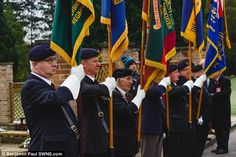 Flag bearers from the Royal Pioneer Corps and Royal British Legion, pictured, marched ahea...