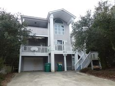 """This beautiful home offers a solar heated pool, lovely interior, hot tub, and a great location in the popular Section K of Ocean Sands. """"Flip Flop'n"""" is conveniently located near all the amenities that Corolla has to offer, including the Outer Banks Center for Wildlife Education, the Whalehead Club, the Currituck Club golf course, and the Currituck Beach Lighthouse.This superb home is designed for comfort and convenience. With family friendly amenities including a Pac N ..."""