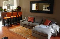 living room colors..love how the gray and orange go together--great idea