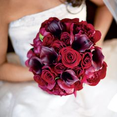 Danielle's lush bouquet was filled with burgundy peonies, Black Magic roses, and burgundy mini calla lilies.