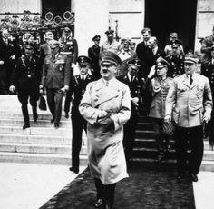 Hitler exiting Munich's Hauys der Deutschen Kunst in 1937 with Krause, Schaub and Bruckner behind him. Goering and Karl Brandt are also visible. @weissepup