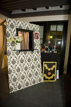 Photobooth.  I'd use an old window and fence for my rustic theme.  I'd leave a ton of disposable cameras in an old bag, suitcase etc something cool.  You can mail the pictures (those who took some) back to them in your thank you cards