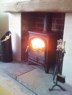 Wood Burning Stoves | Image via uk.pinterest.com