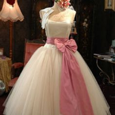 1950s style wedding dress. Love the pink bow!