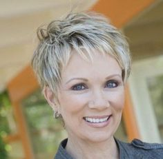 Great pixie haircut for women over 50 with short thick hair! Razor in layers around the crown, around ears on the sides and a tapered neck line in back.