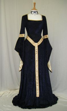 Fabulous elven style gown handmade by me for you to fit you perfectly - made in your measurements  the gown is in a midnight blue crushed velvet the sleeves are semi fitted on the upper half ending with a band of gold braiding with celtic knot design. The lower sleeve is a trumpet shape that is slit so that it reveals the forearm it is lined in gold satin the neckline is trimmed in gold braiding and it has a corset style closure back with lacing corset style closure at the back to adjust to…