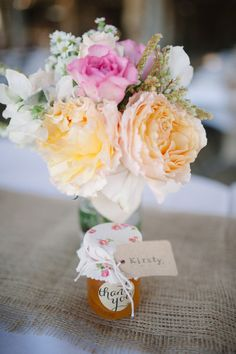 Pretty flowers and jam as favors: http://www.stylemepretty.com/little-black-book-blog/2014/12/16/rustic-meets-romantic-queensland-wedding/ | Photography: Casey Jane - http://www.caseyjanephotography.com/