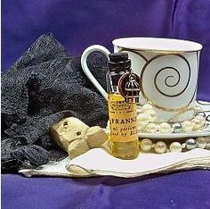 """Perfume by Villainess Soaps based on the e-novella's heroine, Frannie Pleasance. """"Sweets and sadness. Mourning herbs and a lady's lavender with a lemony cup of hot black tea and iced sugar biscuits. """" A 6ml Extrait, accented with a symbolic bronze cage."""