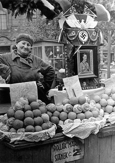 An ethnic German woman, or ' Volkdeutsche', in Poland at a fruit stand showing her love for Adolf Hitler.
