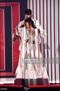 Rapper Machine Gun Kelly and singer Camila Cabello perform onstage at Nickelodeon's 2017 Kids' Choice Awards at USC Galen Center on March 11, 2017 in Los Angeles, California.